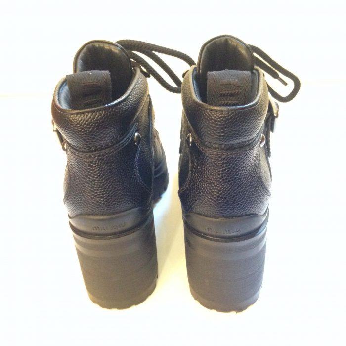 miu miu bottines en cuir a lacets et boucles